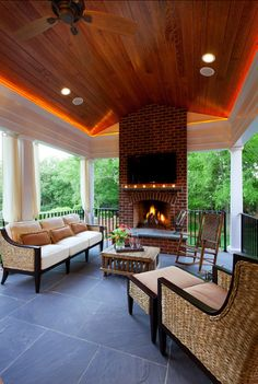 Porch Design Ideas. Inviting porch with fireplace, comfortable patio furniture and LED lighting on ceiling. #Porch #PorchDesign #PatioFurniture