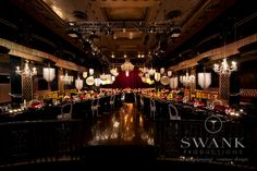 Planned, Designed & Produced by www.swankproductions.com Pink and black deco wedding at the Edison Ballroom NYC. Pink/Red and Gold Reception Decor w/ Glamorous Gold Chandeliers #reception #gay #marriage #gold #red #table #setting #flowers #centerpiece #chandeliers #deco #wedding #decoration #edison #ballroom #creative #beautiful #extravagant #weddng #inspiration #ideas  #glamorous