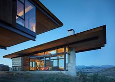 "The mountain landscape of Washington's Methow Valley is the setting for this family retreat, conceived by architect Tom Kundig as four structures arranged ""like a little campground"" around a big rock."