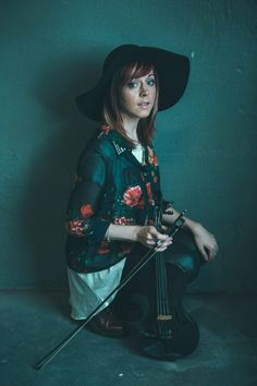 "Lindsey Stirling, the dubstep violinist who went from YouTube stardom to a No. 2 album on the Billboard 200 this year, has a reputation for taking violin to extreme places. | Premiere: Lindsey Stirling Gets Wild In The West For Her ""Roundtable Rival"" Video"