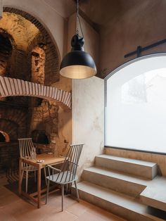 Image 8 of 34 from gallery of Building of the Old Ceramic Society of Coimbra / Luisa Bebiano Arquitectura + Atelier do Corvo. Photograph by do mal o menos Timber Cabin, Timber Beams, Cozy Restaurant, Pottery Workshop, Building Renovation, Stone Masonry, Brick Facade, Industrial, Pine Floors