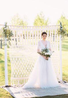 elegant white crochet backdrop arch / http://www.deerpearlflowers.com/boho-macrame-knotted-wedding-decor-ideas/