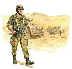 Israeli Defence Force, pin by Paolo Marzioli. Izraelski kapitan spadochroniarzy z 202. Batalionu Spadochronowego w amerykańskim hełmie M-1 i w mundurze maskującym francuskich spadochroniarzy. Uzbrojony w pistolet maszynowy Uzi, pin by Paolo Marzioli