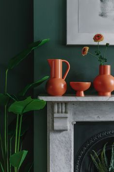 The future's bright. the future is an orange mantelpiece. We adore this orange pottery range from Raawii in Denmark and love how the bright colour pops from the dark green walls of this living r Dark Green Living Room, Living Room Decor Brown Couch, Dark Green Walls, New Living Room, Living Room Decor Orange And Brown, Orange Rooms, Orange Walls, Green Rooms, Room Color Schemes