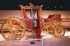 Vladimir Chernyshev, Hermitage curator of carriages, inspects the 1896 coronation coach of Czar Nicholas II on Friday, July 24, 1998 in Wilmington, Delaware. The coach is on display as part of the Nicholas & Alexandra exhibition