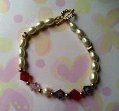 Grandmother's bracelet  Made with 6x8 white Pearls, Brilliance crystals with Gold accent. Birthstones Feb, Jan, Feb, June, Oct & Jan. Sold
