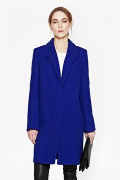 "<ul> <li> Wool-blend coat</li> <li> Long sleeves</li> <li> Pronounced front lapels</li> <li> Concealed centre-front popper placket</li> <li> Front pockets</li> <li> Centre-back hem split</li> <li> UK size 10 length is 90.5cm</li> </ul>  <strong>Our model is 5ft 9"" and is wearing a UK size 10.</strong>"
