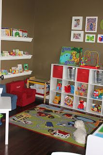 Perfect cute play room. Has to have hardwood floors and even I remember playing with that rug as a kid. Very nice.