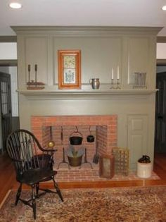 COLONIAL FARMHOUSE – INTERIOR – vintage early american farmhouse showcases raised panel walls, barn wood floor, exposed beamed ceiling, and a simple style for moulding and trim, like in this farmhouse. Primitive Homes, Primitive Fireplace, Country Fireplace, Old Fireplace, Bedroom Fireplace, Fireplaces, Fireplace Ideas, Fireplace Pictures, Primitive Bedroom