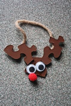 Puzzle Piece Reindeer- Glue three puzzle pieces together (you may want to prep this ahead of time with a glue gun).  Have children paint pieces brown.  Attach googly eyes and a red pompom nose.