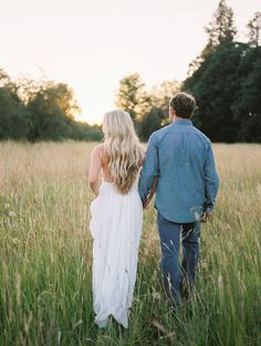Sweet country engagement photos in sun-kissed fields via Magnolia Rouge
