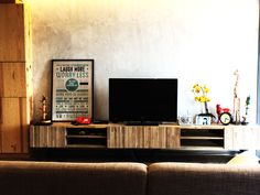 RSDS Architects - Singapore interior design renovation - living room with industrial look - raw cement plastered feature wall