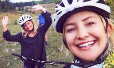Kate Hudson beams as she poses with mother Goldie Hawn