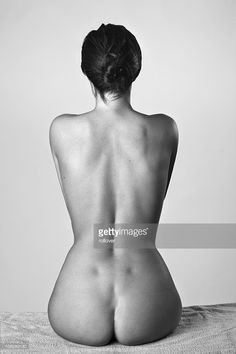 Naked woman sitting, rear view : Stock Photo