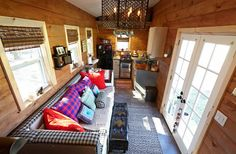 This is the 276 sq. Nomad's Nest tiny house on wheels designed and built by Wind River Tiny Homes in Chattanooga, Tennessee. In fact, Jeremy & Lindsay Weaver, of Wind River Tiny Homes, are . Small Room Design, Tiny House Design, Bungalows, Zottiger Bob, Small Houses On Wheels, Tiny House Nation, Outdoor Kitchen Design, Kitchen Seating, Kitchen Layout