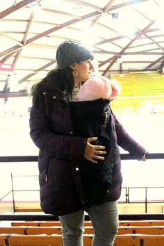 This hockey mom knows how to keep her little one warm and happy. The extendher is a Maternity and Babywearing jacket extender. A unique clip-on system allows the extendher to attach to any coat that has a zipper. Just clip and zip. www.theextendher.com