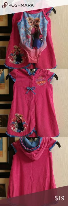 Frozen Swim Set Elsa and Anna one piece swimsuit. Worn a couple of times. No tears or snags. In perfect condition. Cover up - never worn. Hooded with ruffle trim. Disney Swim One Piece