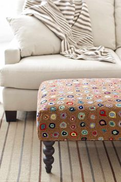 #DashAndAlbert Cat's Paw Brown Turned Leg Ottoman. Get on the hot seat with our back-by-popular-demand rug ottomans, shipped for free! Cushioned bench topped with a smashing Dash  Albert wool hooked rug, with eye-catching turned wood legs.