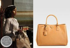 Olivia Pope (Kerry Washington) wore this caramel leather tote in an episode of Scandal.  It is the Prada Saffiano Luxe Leather Tote in Grey and Gold. Buy itHEREfor $1,730.