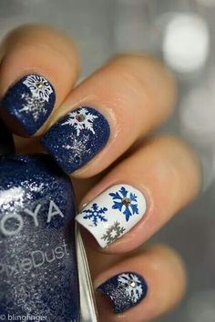 Christmas nails. Royal blue with white&silver snowflakes and a white nail with blue&silver snowflakes