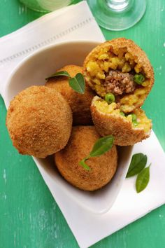 Arancini or arancine? Whatever you call them, these stuffed and fried Sicilian rice balls are delicious.