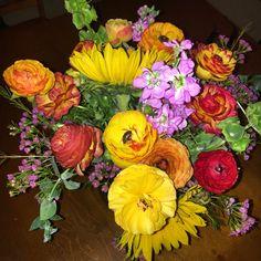 Sunflowers and ranunculas summer flowers