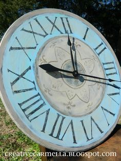 She used the cheapo round tables with screw in legs for this clock