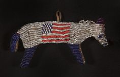 Made ca 1880-90, this fetish is pieced and sewn from hide and cloth in the form of a horse, decorated with beadwork in patriotic colors that includes American flag imagery.  Patriotic symbols are unusual on a fetish. From Jeff Bridgman American Antiques.