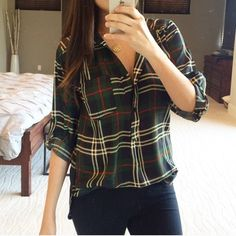 """Olive and navy plaid top The perfect fall/winter plaid blouse. Wear tucked into jeans or over leggings. Button front, rolled tab sleeves, polyester. No trades, no offers. Price is firm. I'm 5'5"""" wearing small. Tops"""