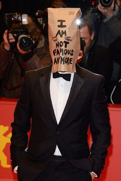 Shia LaBeouf== You will need: Suit, brown paper bag. | 17 Lazy Halloween Costumes You Can Use Your Normal Clothes For