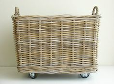 OK -- now how hard can it be to attach casters to a basket? Great storage for a throw or extra pillow. Def on the to-do list