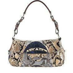 Prada Snakeskin Patchwork Flap Shoulder Bag.  Founded by Mario Prada in 1913, the Italian fashion label of Prada is renowned for its original, yet practical designs. Each piece of the collection is meticulously crafted with the finest materials, consistent with its heritage as a leathergoods shop. With a continuously artistic array of handbags and accessories, the brand remains a highly-coveted household name.