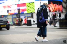 Woman crossing the street in Piccadilly Circus