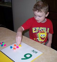 Velcro dots on a counting book and on pompoms to help with 1-to-1