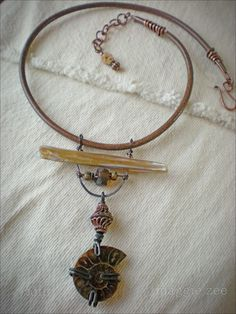 Spiral Ammonite and Leather Amulet Choker by maggiezees on Etsy