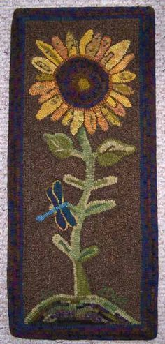 Primitive Animal Rug Hooking Design,  A very tall sunflower with a winding stem. On one leaf rests a dragonfly taking a break from flying. What a fun design!