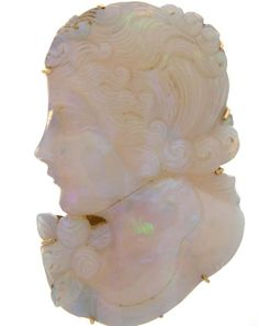 Vintage carved opal cameo pendant/brooch.