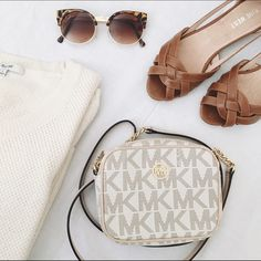 """LIST   Michael Kors • Signature Mini Crossbody ✨HOST PICK x2✨Excellent condition, only used it for a few times but didn't match my current closet. Dimension: 6 1/4"""" x 4 3/4"""" x 1 1/2"""". Michael Kors signature Crossbody, with the gold chain & leather belt (25 1/2"""" when lay in flat). Please note that the cards slide has very little scratch (see pic 4).  • No trade, my closet is full • Bundle to save on shipping  • Feel free to ask me any questions • Reasonable offers through offer tab  Michael…"""