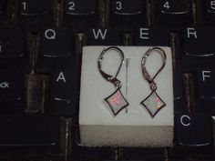 LOOK!!! A BEAUTIFUL PAIR OF STERLING SILVER AND WHITE FIRE OPAL EARRINGS