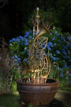 French Horn Regatta- 68 in. H, 28 in. W, 20 in. D. Musical instrument fountain sculpture – copper tube, French horns, flutes, a trumpet, a water wheel, brass and silver pieces.