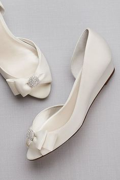 A classic pair of satin wedges, adorned with a crystal-centered bow. Satin upper, synthetic sole 1 wedge Imported A classic pair of satin wedges, adorned with a crystal-centered bow. Wedding Wedges, Wedge Wedding Shoes, Wedding Boots, Wedge Shoes, Wedding Flats For Bride, Casual Wedding, Bride Shoes, Prom Shoes, Best Bridal Shoes