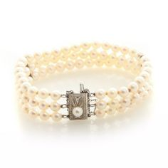 Genuine Art-Deco Mikimoto Pearl Bracelet RARE AA Quality 5.5mm 3 strand.  Genuine and Original Mikimoto Art-Deco piece from the early 1930's featuing 3 5.5mm Pearl strands held together by silver stations. --- A work of art!