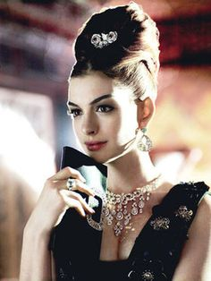 Anne Hathaway looking dazzling and mimicking Audrey Hepburn's look in Breakfast at Tiffanys
