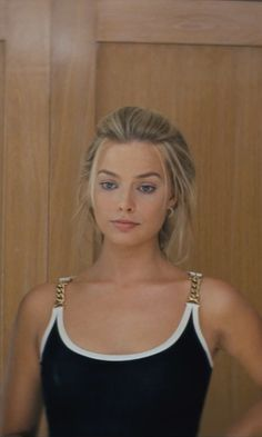 Image result for margot robbie wolf of wall street black dress