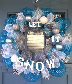 - Wire wreath frame covered with silver, blue and white mesh, silver shimmery snowflakes and blue and silver snowflake ribbon. - This wreath is decorated with matte blue, glittered silver and white or Christmas Projects, Christmas Fun, Holiday Fun, Christmas Ornaments, Deco Mesh Wreaths, Holiday Wreaths, Holiday Crafts, Winter Wreaths, Ribbon Wreaths