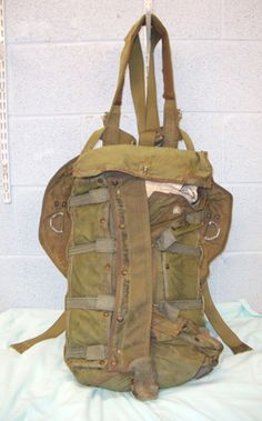 Post WW2 U.S. Navy Parachute Pack Complete With Harness, Buckles & White Parachute. Sn 8344.