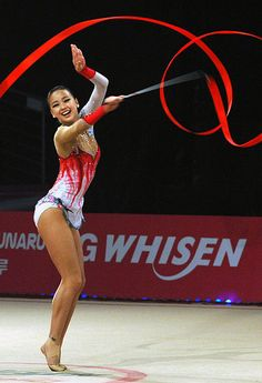 South Korean rhythmic gymnast Son Yeon-Jae performing with ribbon (2012).