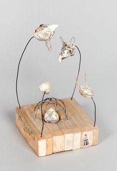emTalk is Cheap/embr /Book fragments, wire, papier maché, PVA glue, gut, 7.5 x 3.75 x 4 inches, 2007 -by Lisa Kokin