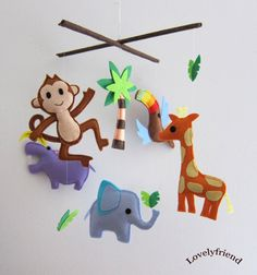 Jungle Theme Nursery Mobile from Etsy.  From the lovelyfriend shop. Adorable.