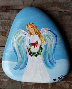Very pretty angel rock. very pretty angel rock acrylic painting Acrylic Painting Rocks, Pebble Painting, Pebble Art, Stone Painting, Rock Painting Pictures, Rock Painting Ideas Easy, Rock Painting Patterns, Rock Painting Designs, Stone Crafts